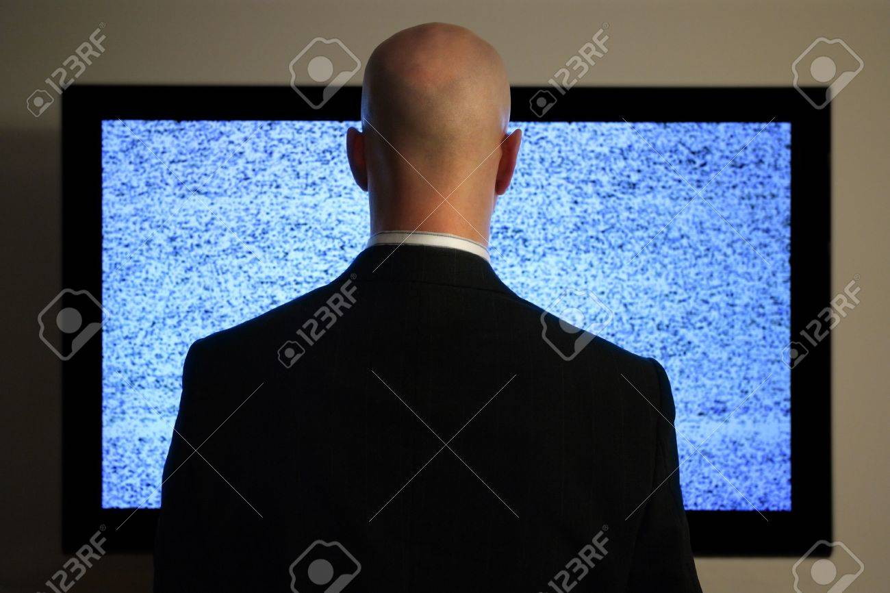 A man watching a blank or static screen of his television. Stock Photo - 4126792