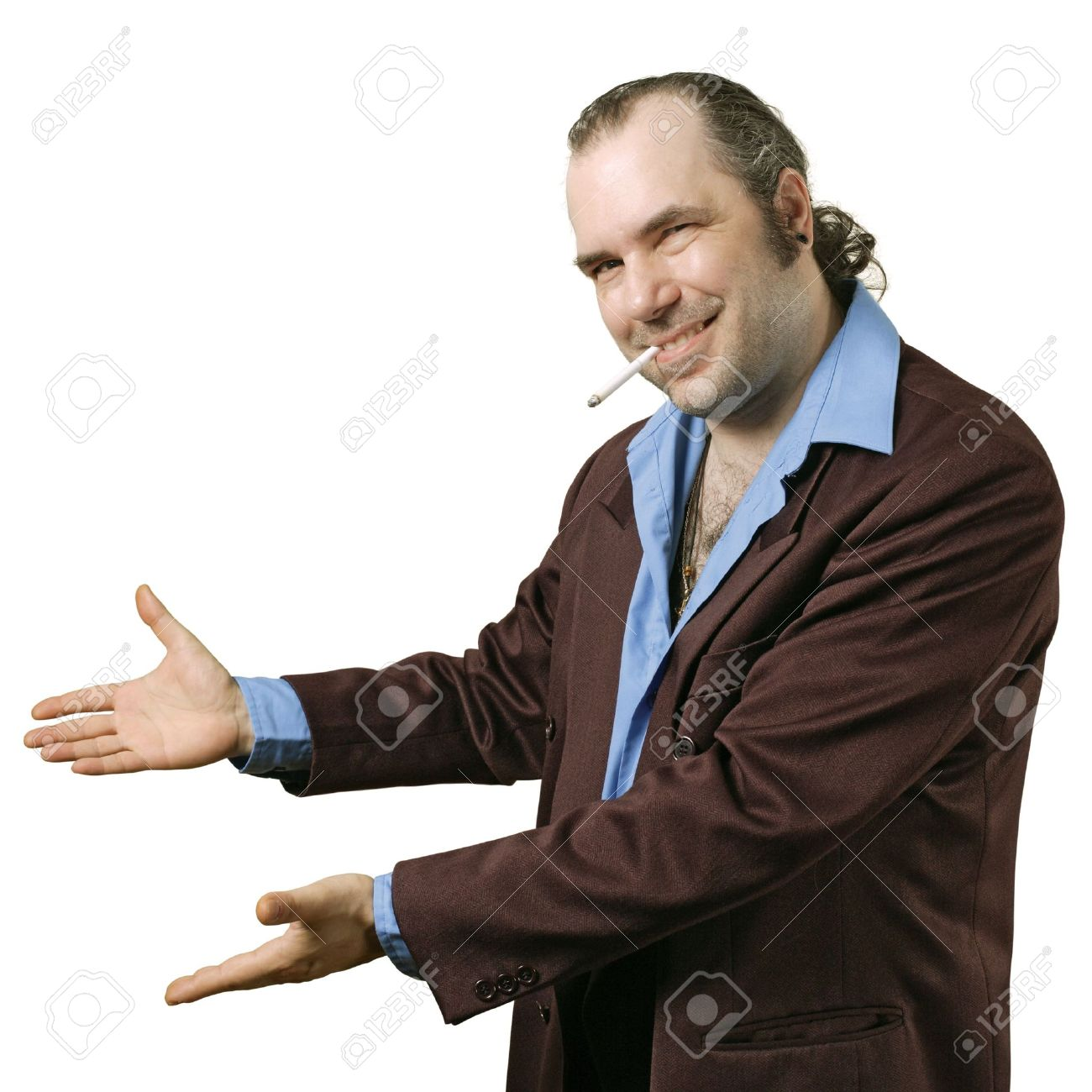 A sleazy car salesman, Con man, retro suit wearing man with happy smile showing you his deals. Stock Photo - 7512921