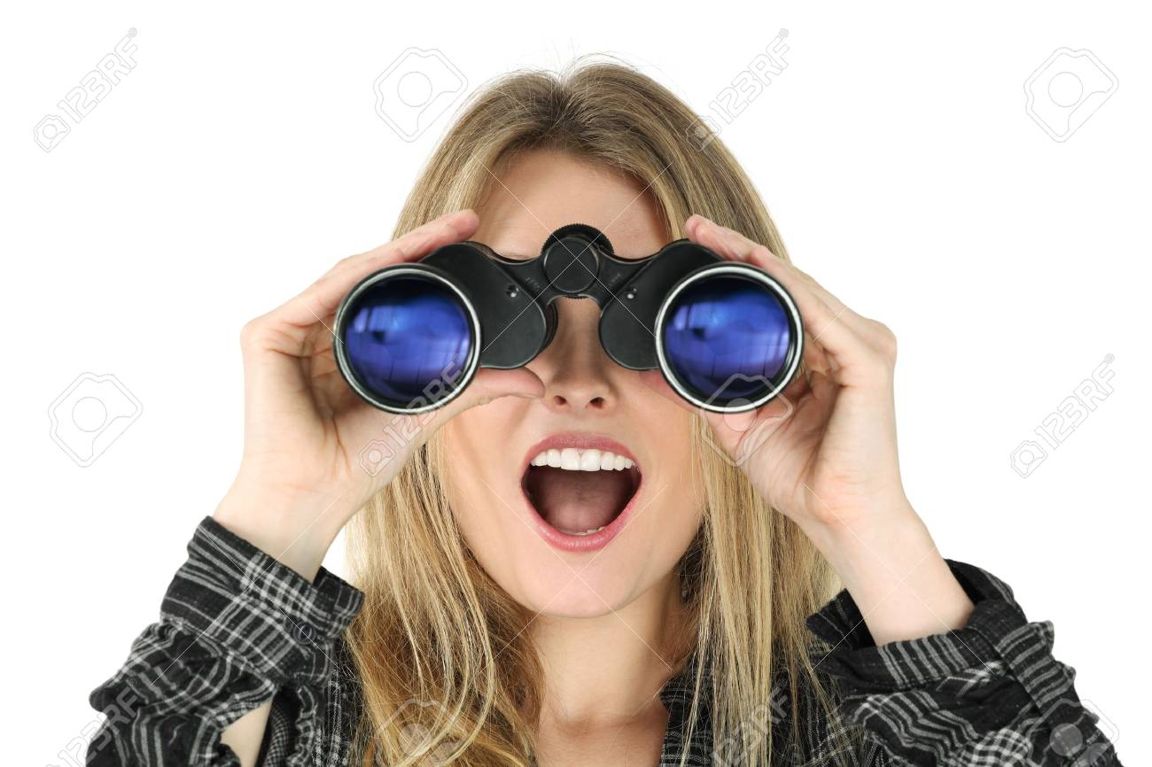 a beautiful blond woman searching with binoculars and looking surprised. Stock Photo - 8821990