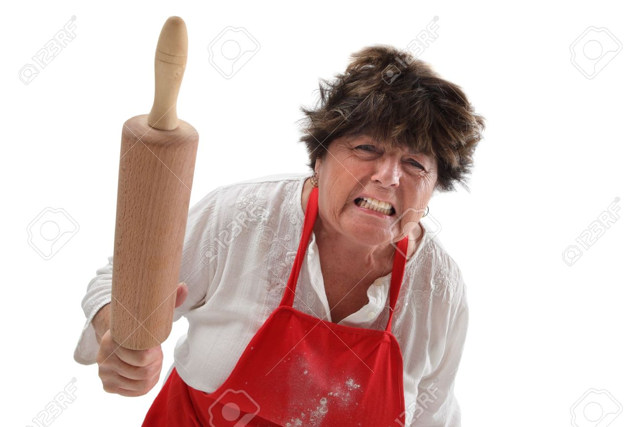 Photo of an angry old woman threatening with a rolling pin. Stock Photo - 10954203