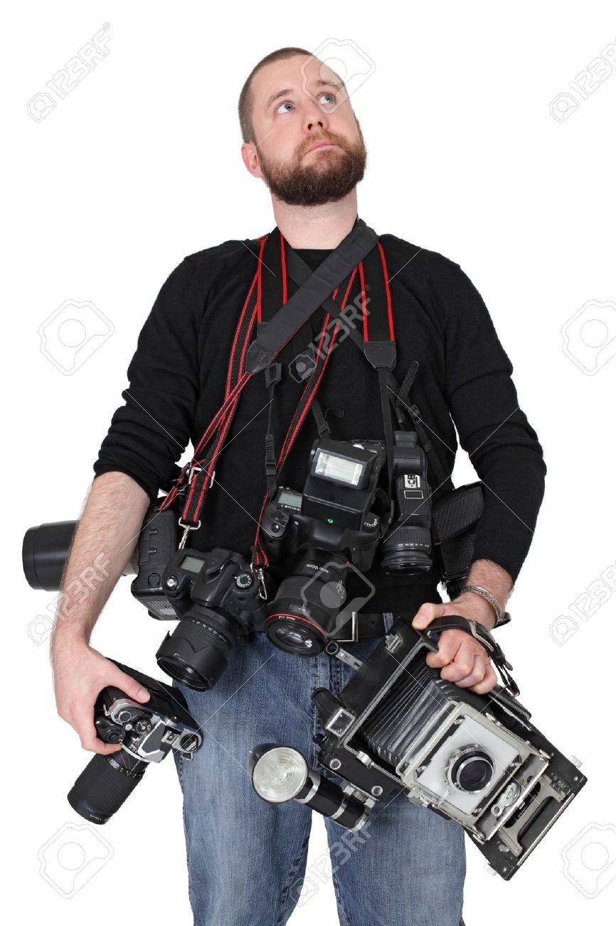 Photo of a man in his late twenties, standing and holding many cameras, film, digital, medium format and large format. Stock Photo - 11056819