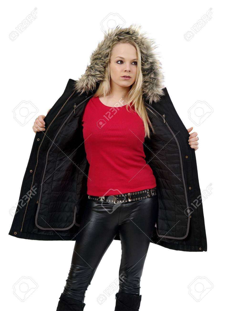 ea1eb8c7 Stock Photo - Young beautiful blond female opening her winter jacket to  show the blank red t-shirt she is wearing. Ready for your design or artwork.