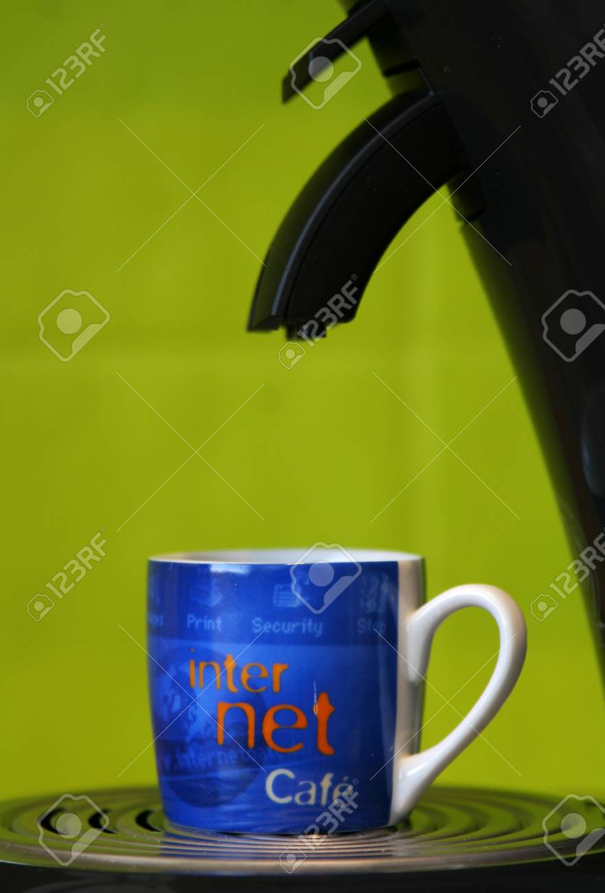 Internet marked coffeecup standing on a coffeemaker Stock Photo - 755612