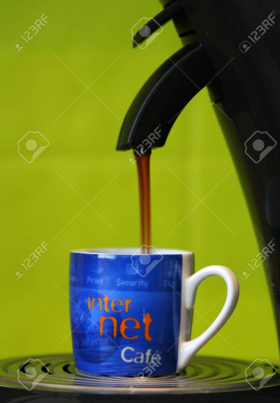 Coffeecup with internet-cafe written on it standing on a coffeemaker while coffee is pouring into the cup, taken at 2 sec so stream of coffee is blurred Stock Photo - 755405