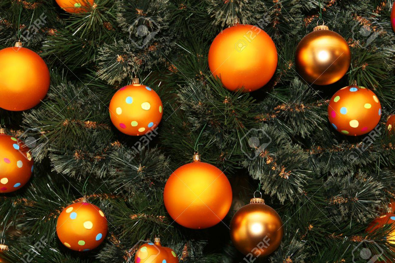 cropped shot of a christmas tree dotted with golden colored balls Stock Photo - 755051