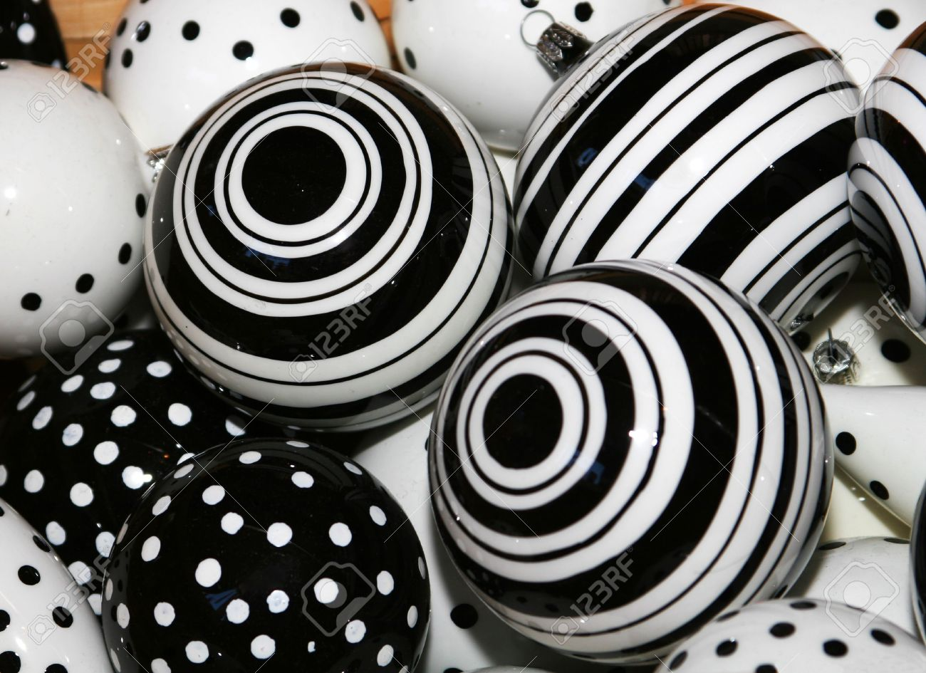 cropped shot of black and white christmas ball decorations stock