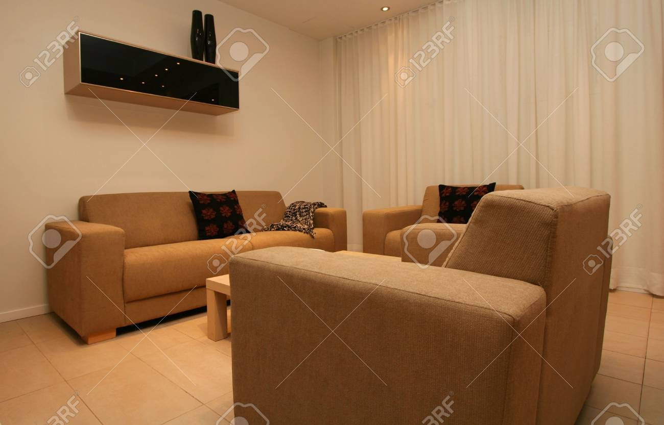 living room, with clean uncluttered and modern design, big sofa..