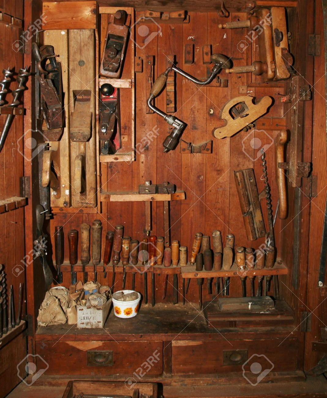 Very Old And Worn Woodworking Tools In Worn Down Cabinet Stock Photo