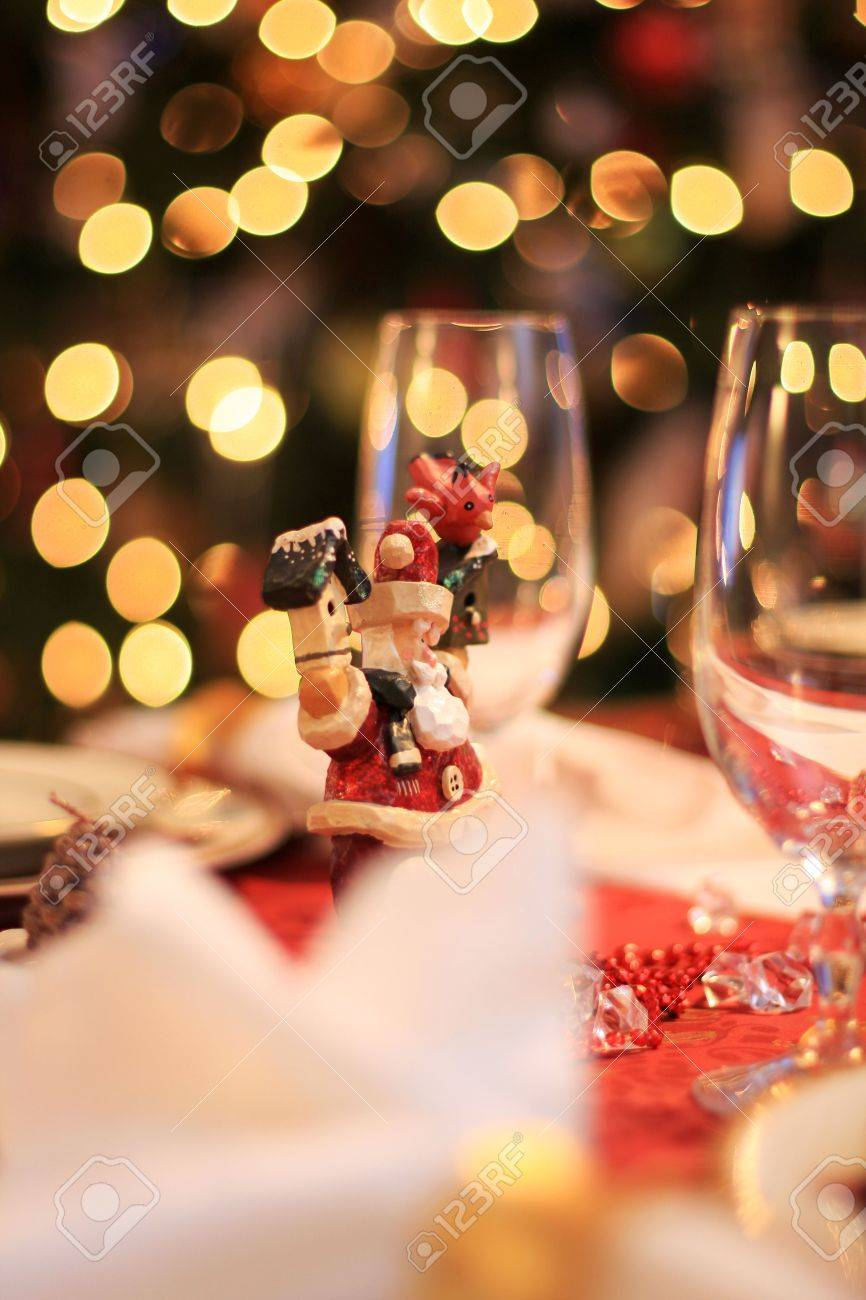 Table Set For Christmas Dinner santa clause decoration on a table set for christmas dinner