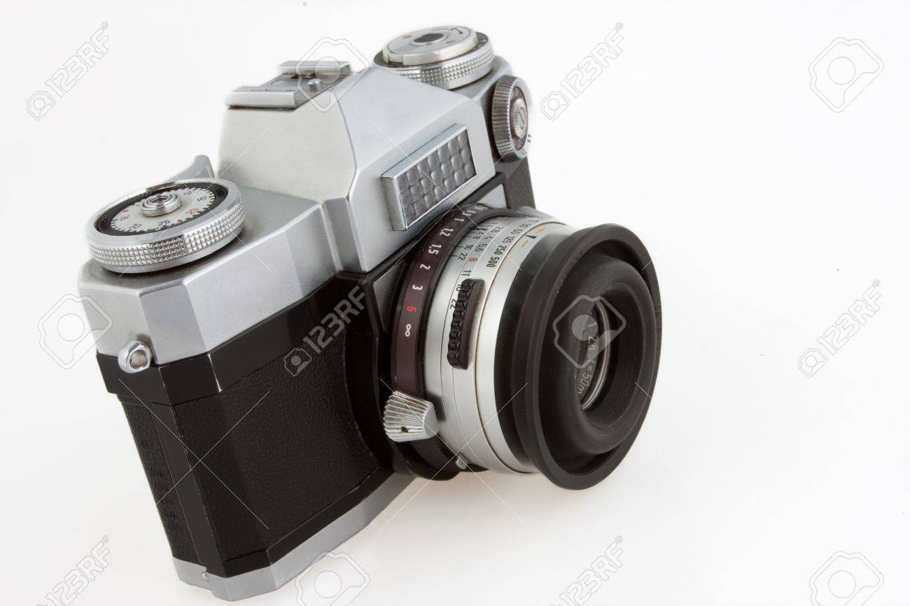 Old vintage SLR film camera isolated on white. Stock Photo - 9856878