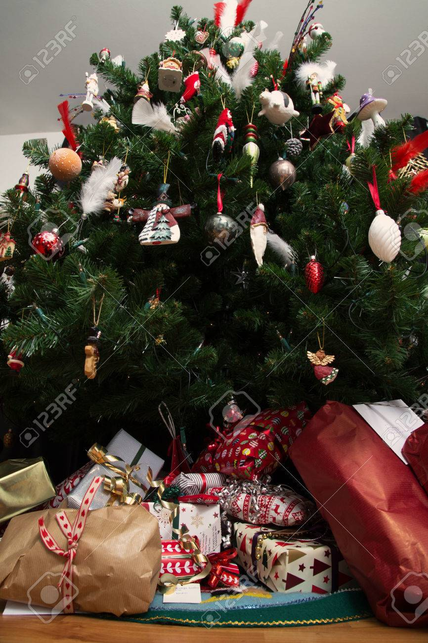 Christmas Presents Under A Christmas Tree Sfrom Below With A Wide Angle Lens Stock