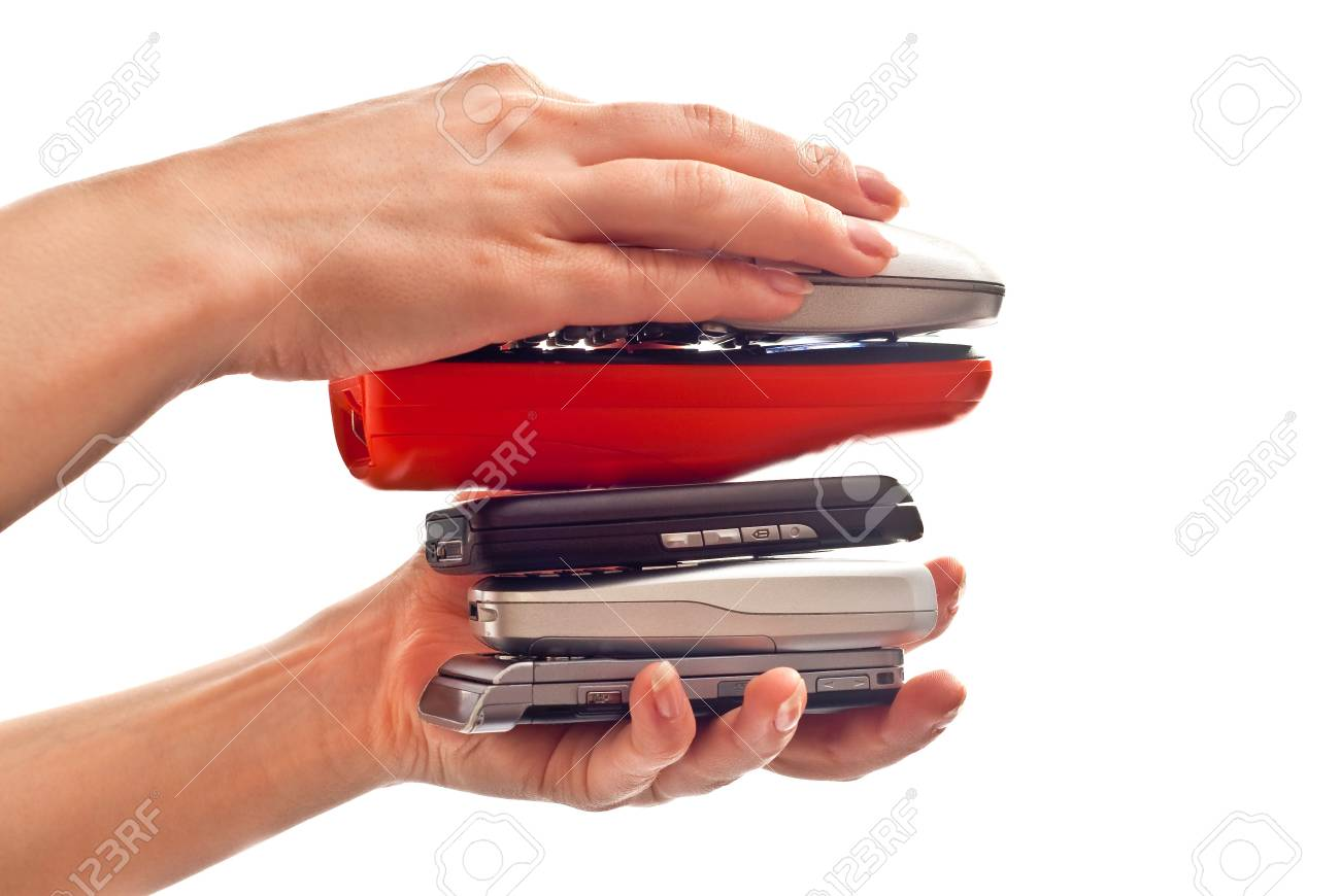 Hill from mobile phones in woman's hands. studio shot Stock Photo - 7412036
