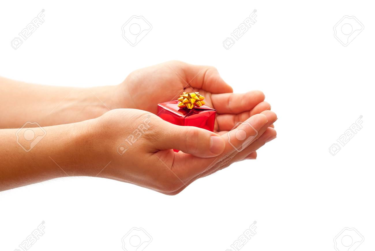 Man holding a gift. Isolated on white background Stock Photo - 8152537