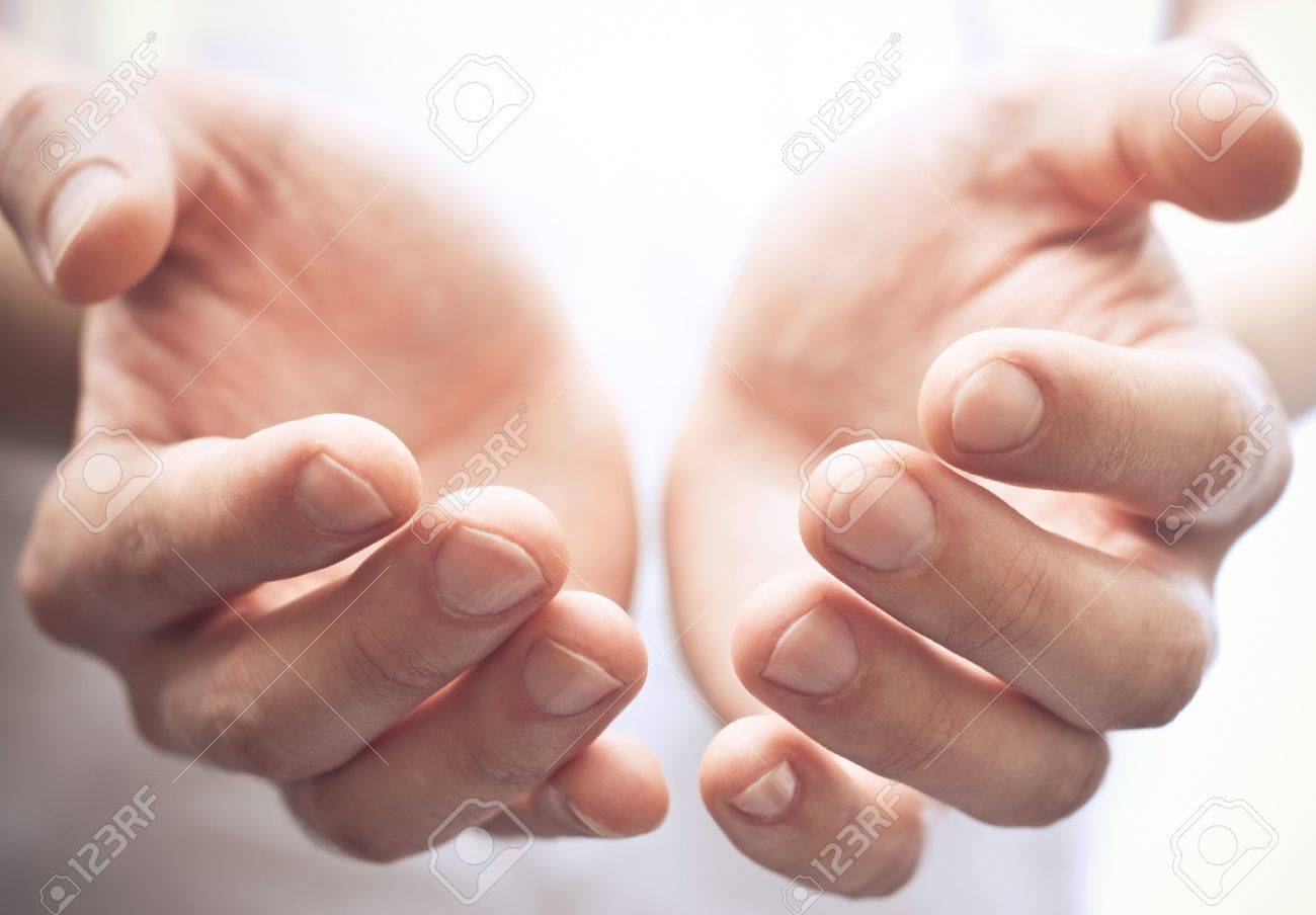 Male hands as if holding something. Focus on finger-tips Stock Photo - 8152616