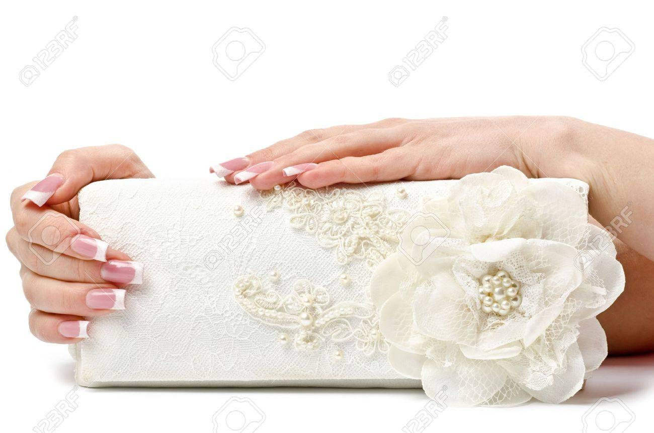 Perfect manicure on female hands. White background Stock Photo - 12934579
