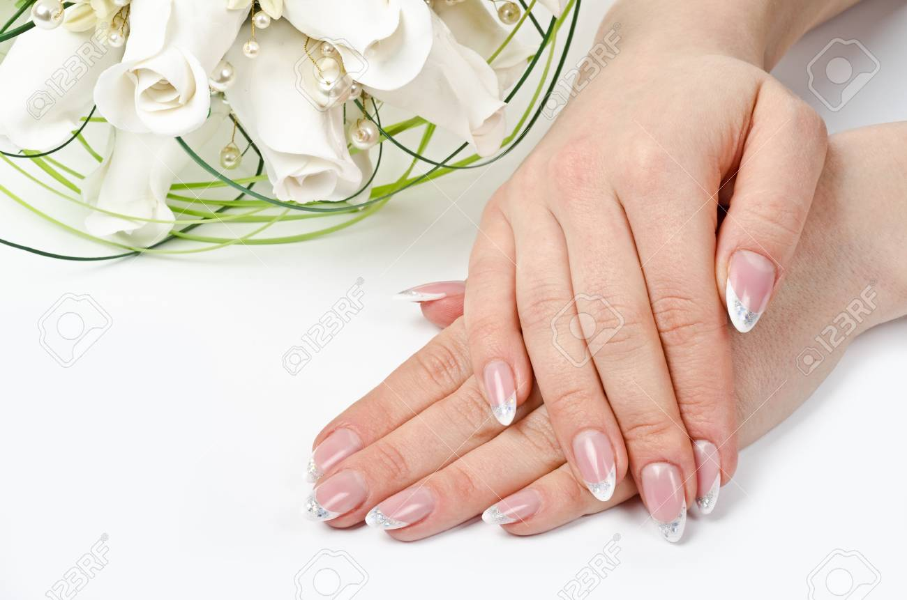 Female hands with perfect manicure and flowers - beauty treatment Stock Photo - 13098910