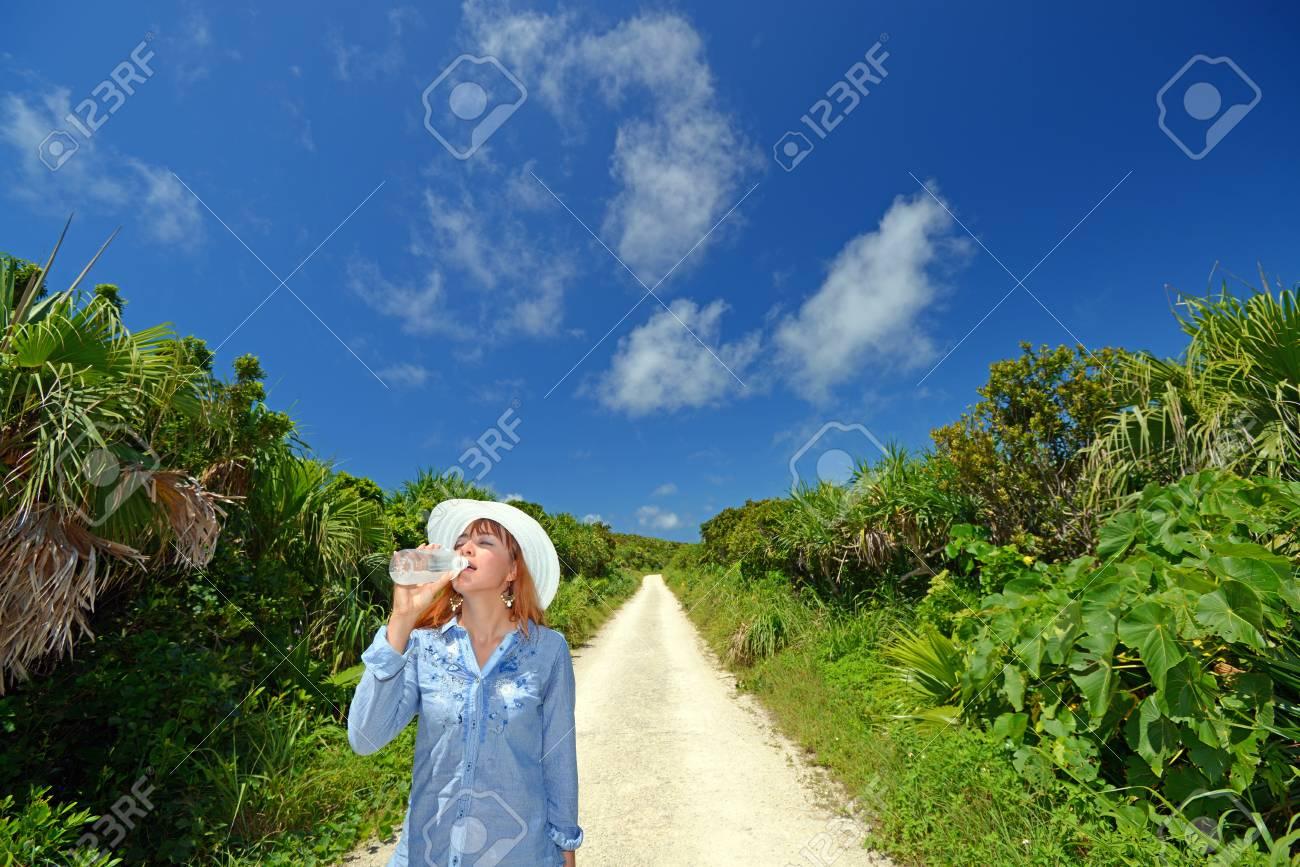 Women enjoy the sun Stock Photo - 14966669