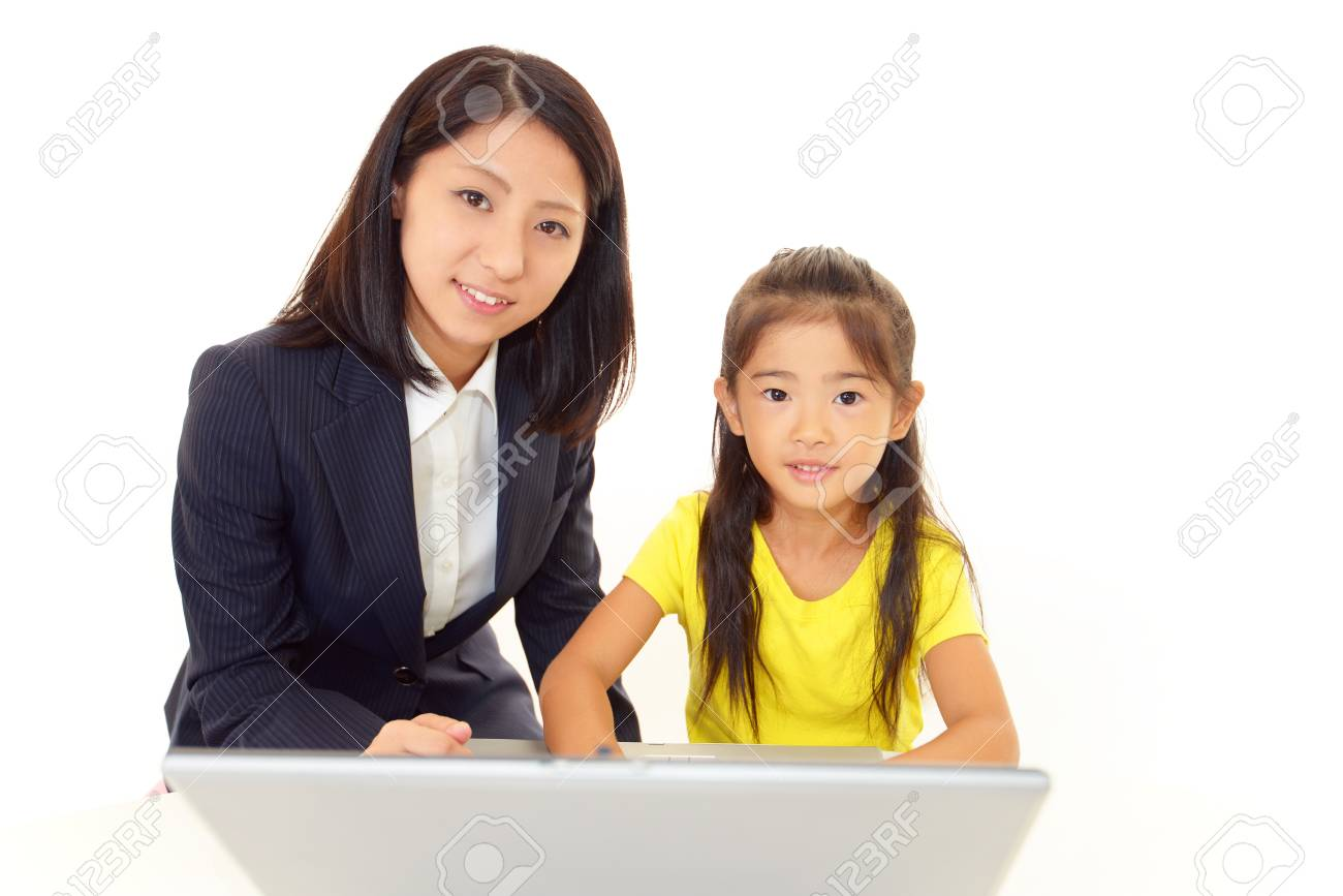 Smiling girls using a laptop Stock Photo - 16169032
