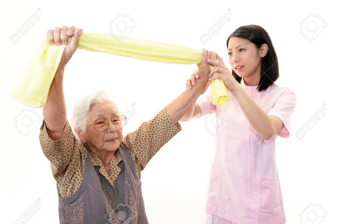 Senior woman with her home caregiver Stock Photo - 16689493