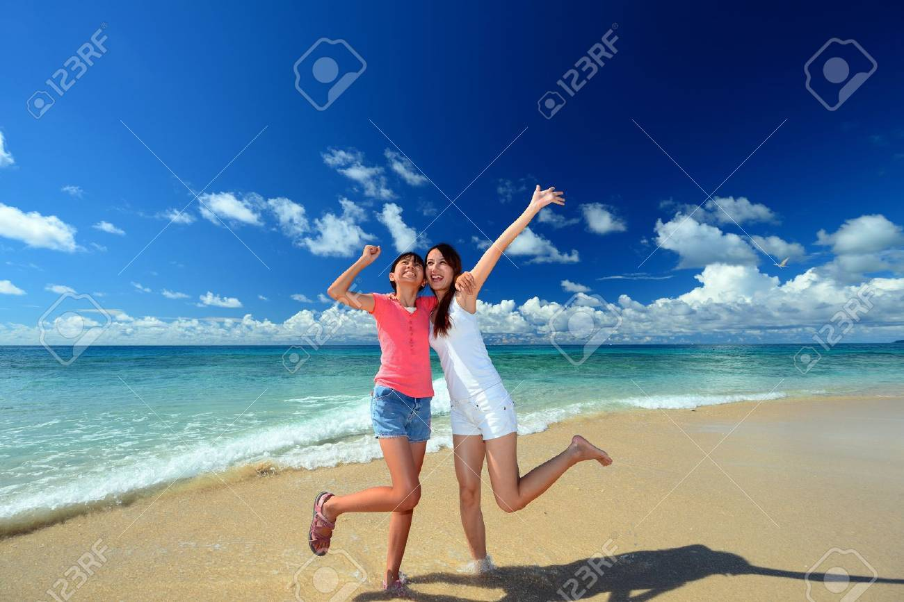 Family playing on the beach in Okinawa Stock Photo - 18233536