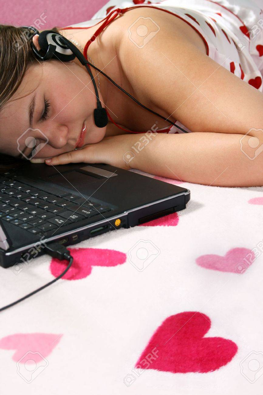 Tired  girl is sleeping near the laptop Stock Photo - 2956959