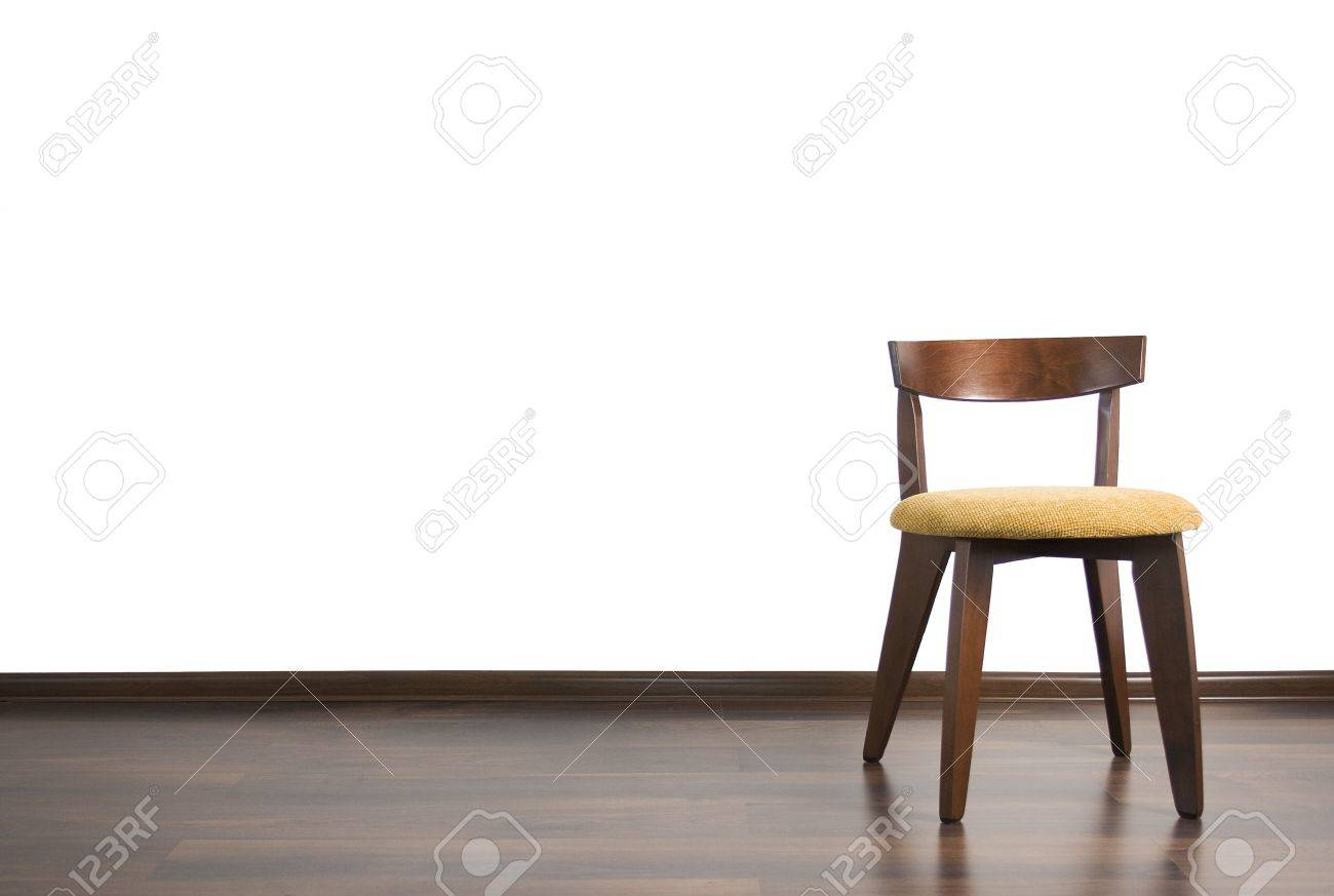 Empty chair in room - Chair Is Located In The Empty Room On The White Background Stock Photo 5164931