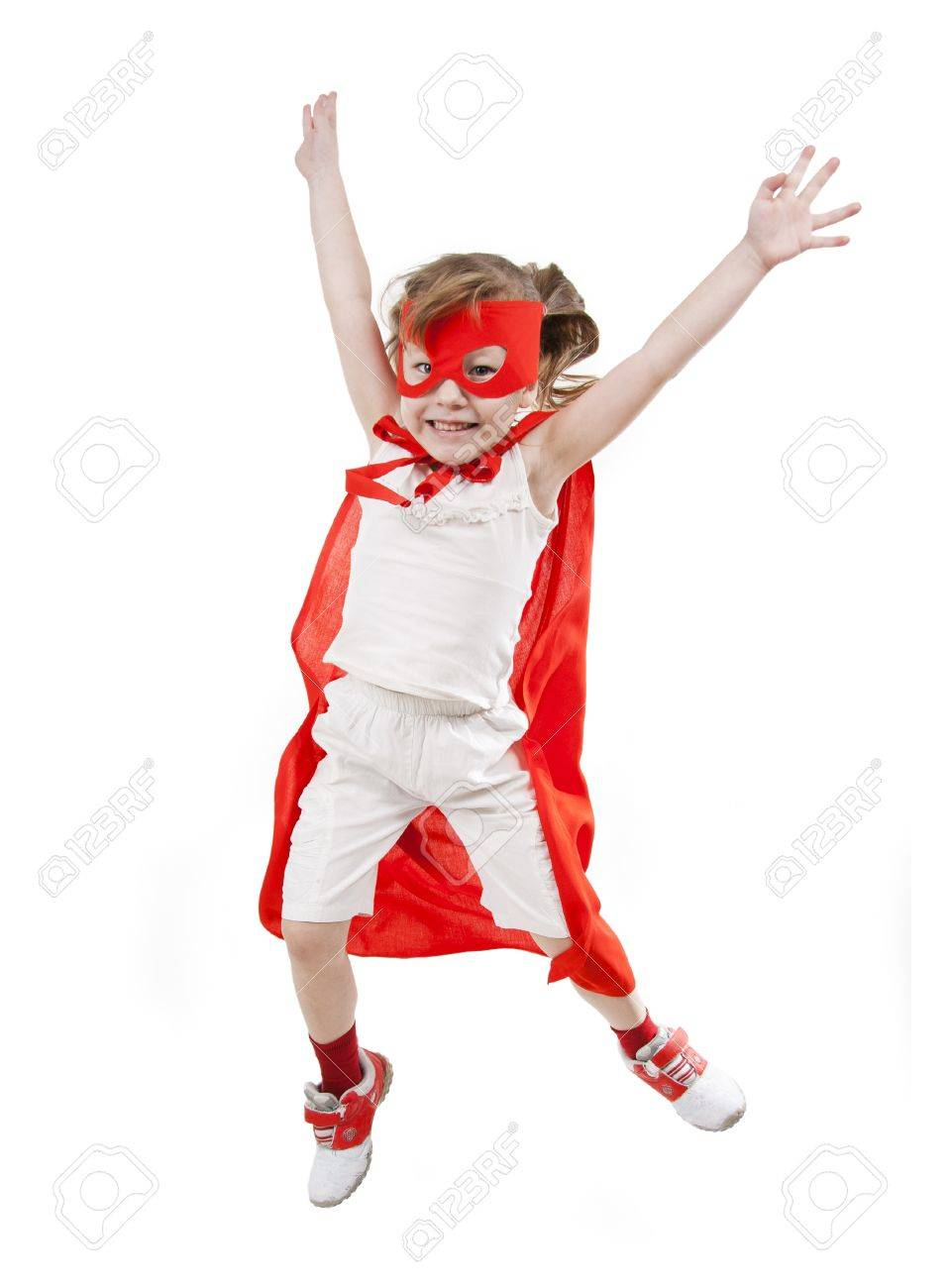 Superhero little girl in a red raincoat and a mask Stock Photo - 8929129