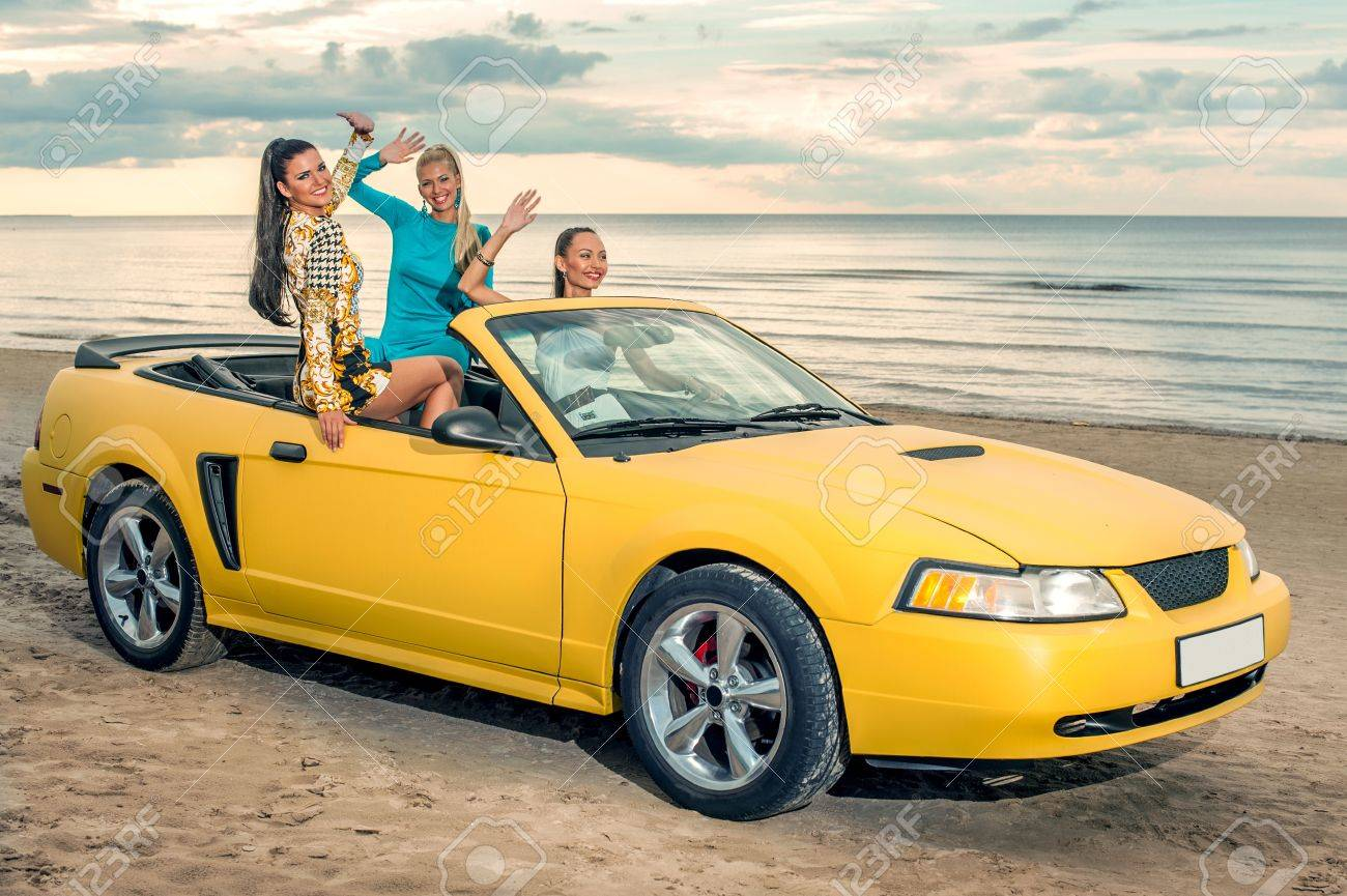 Three Girls With Sport Car On A Beach Stock Photo Picture And