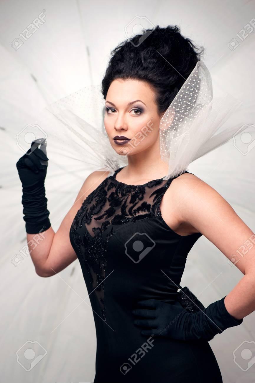 Young elegant queen in black dress Stock Photo - 24260804