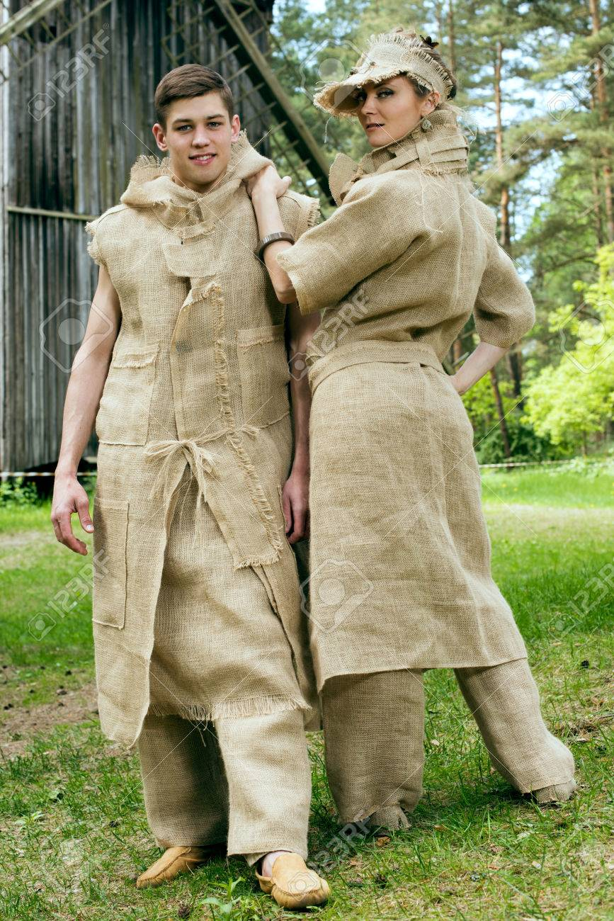 Original Costumes.Ancient Medieval Couple In Original Costumes From Gunny Sacking