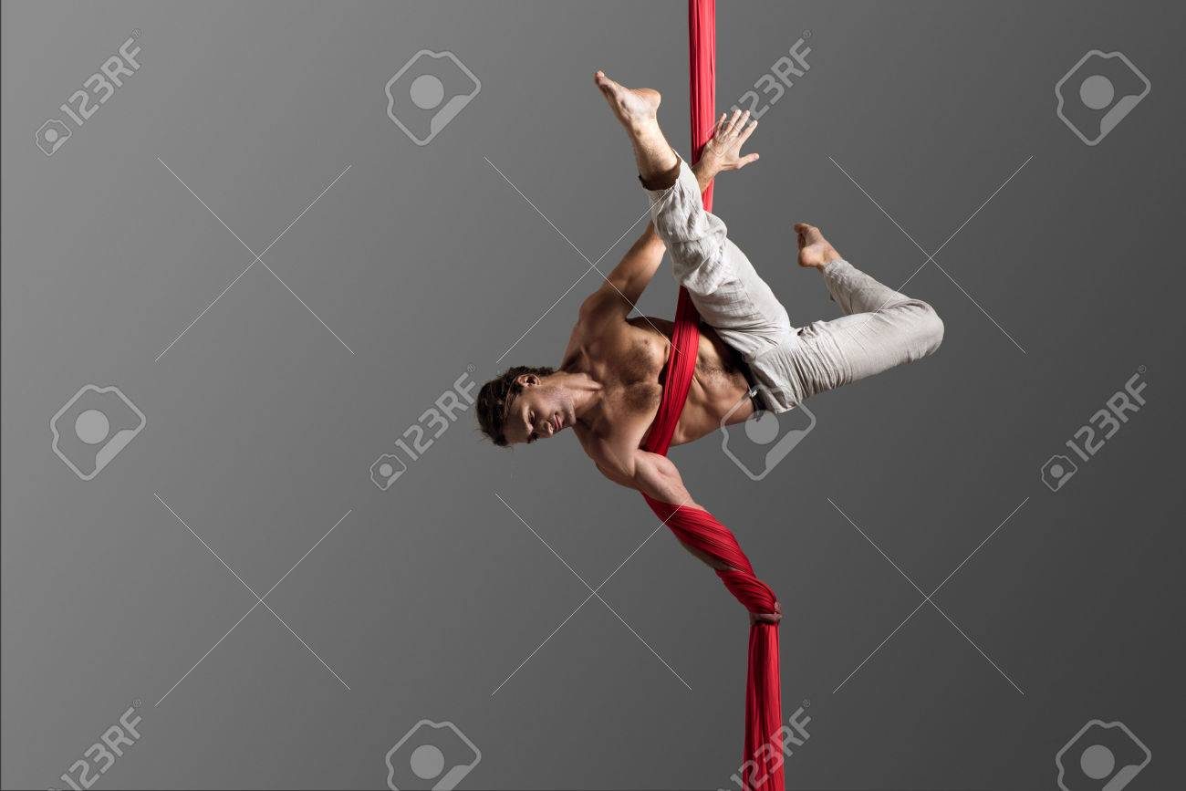 Sporty Young Man Doing Exercise With Elastics, Aerial Silk Ribbons ...
