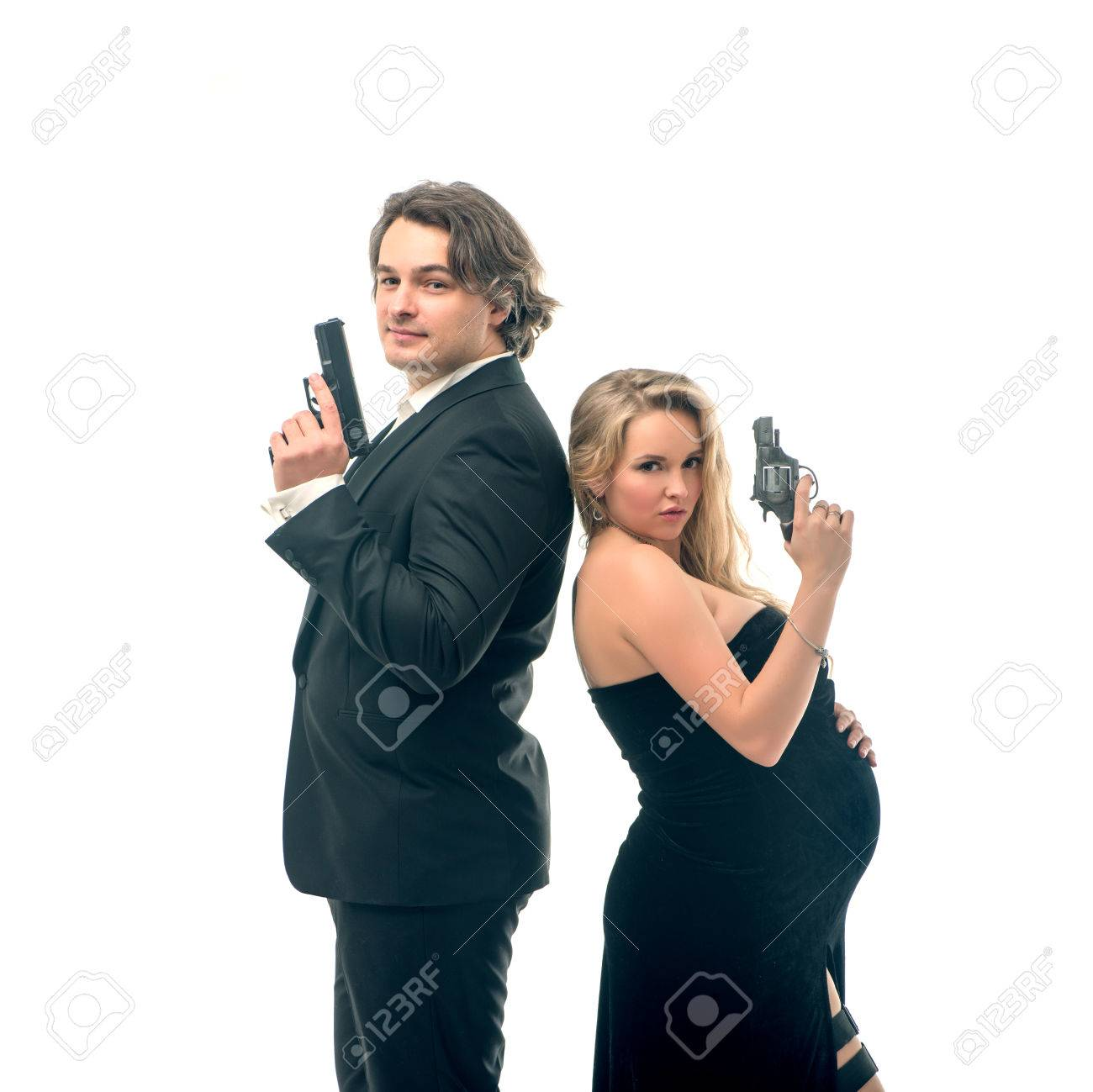 Pregnant fashion woman and husband in gangsta style in mr and