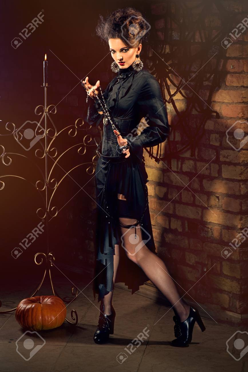 Young sexy witch dressed in vintage dress Stock Photo - 48881023 8e8c682cb