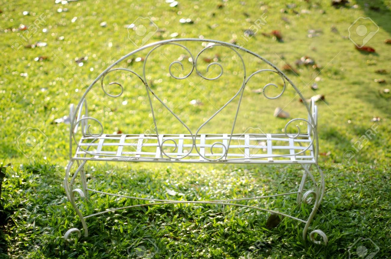 Marvelous A White Color Iron Bench On The Green Grass Field On A Small Gamerscity Chair Design For Home Gamerscityorg