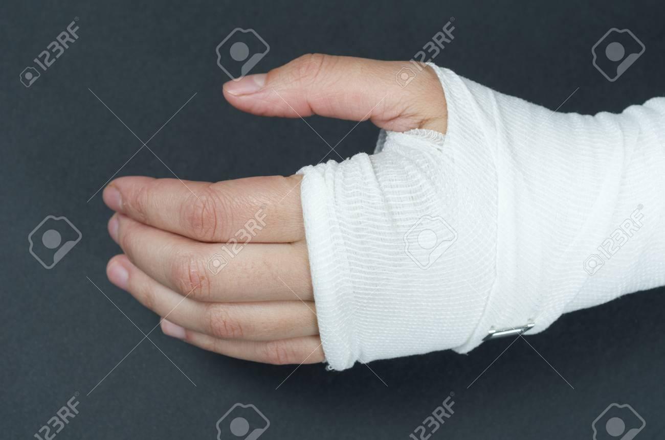 Hand Tied Elastic Bandage On A Black Background Stock Photo