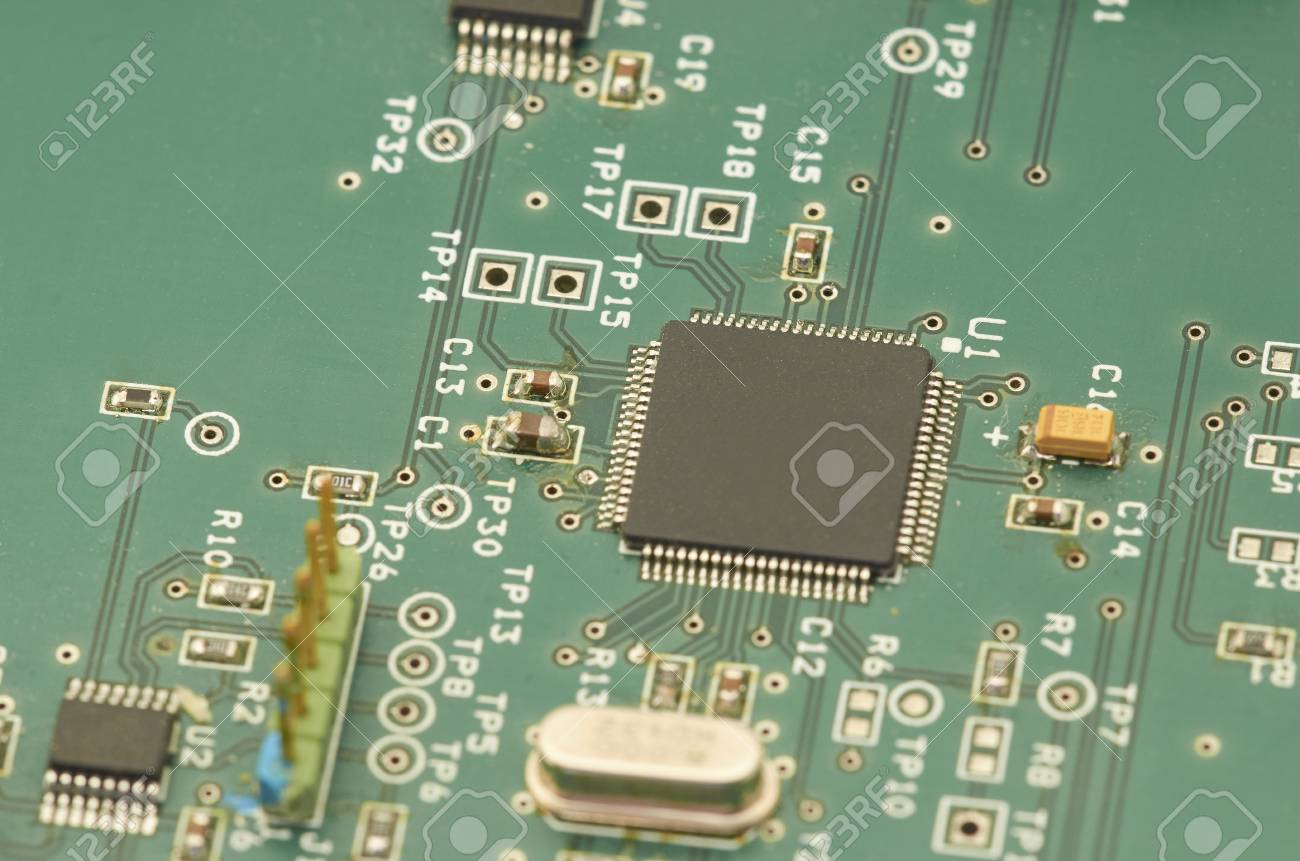 Electronic Circuit Board Pcb Printed With Processor Microchips And Glowing