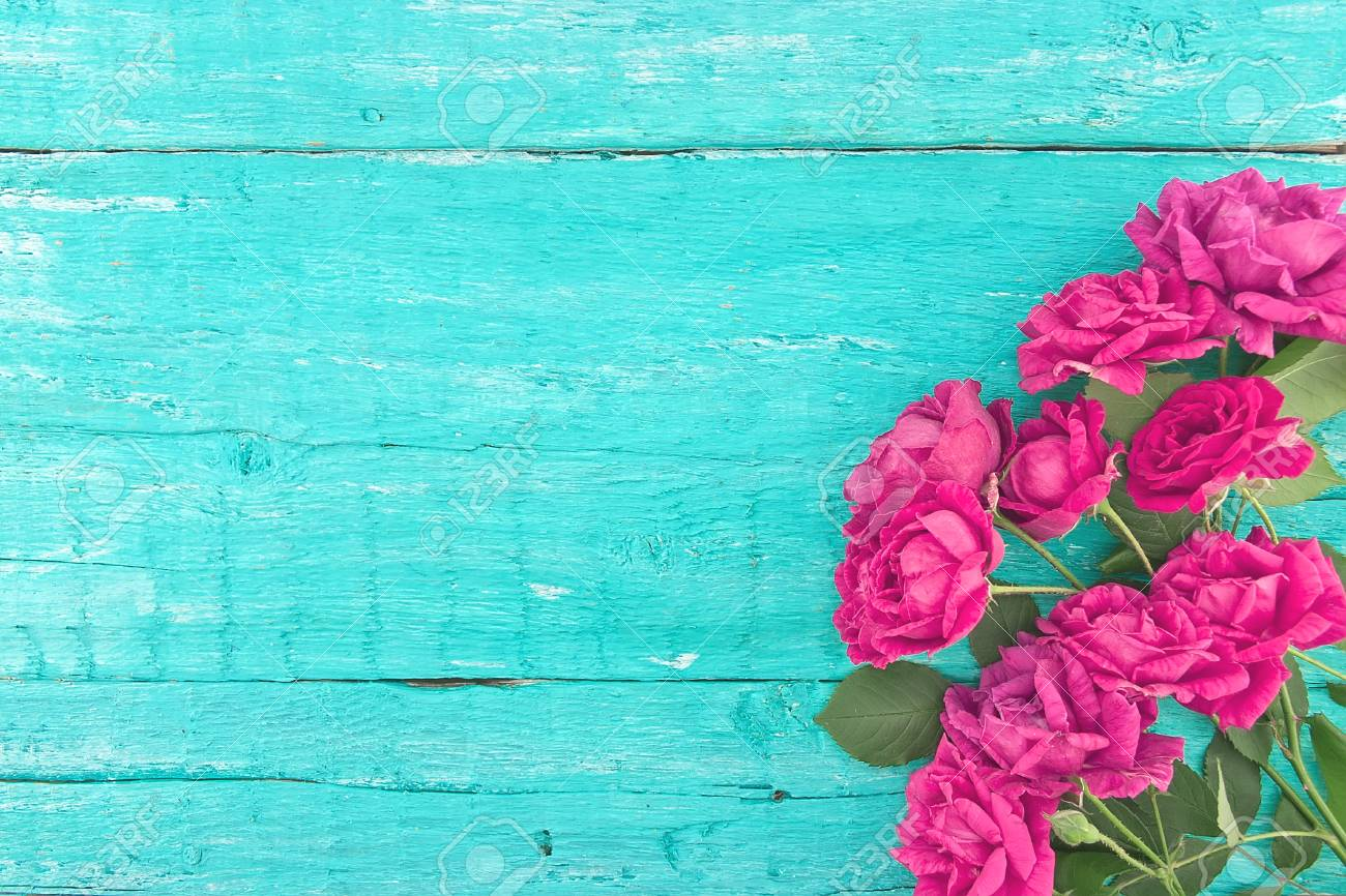 Frame Of Roses On Turquoise Rustic Wooden Background Spring Flowers Valentines
