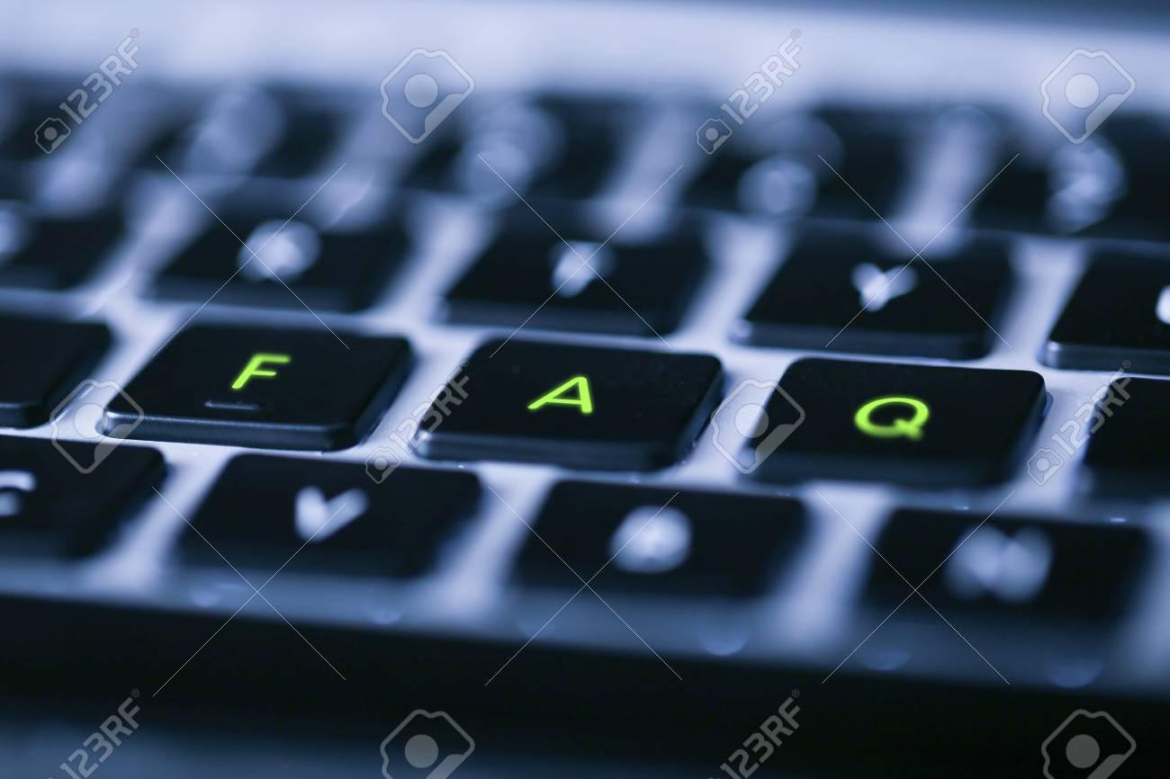 Close-up Shot of FAQ concept laptop keyboard of New war technology. - 97188275