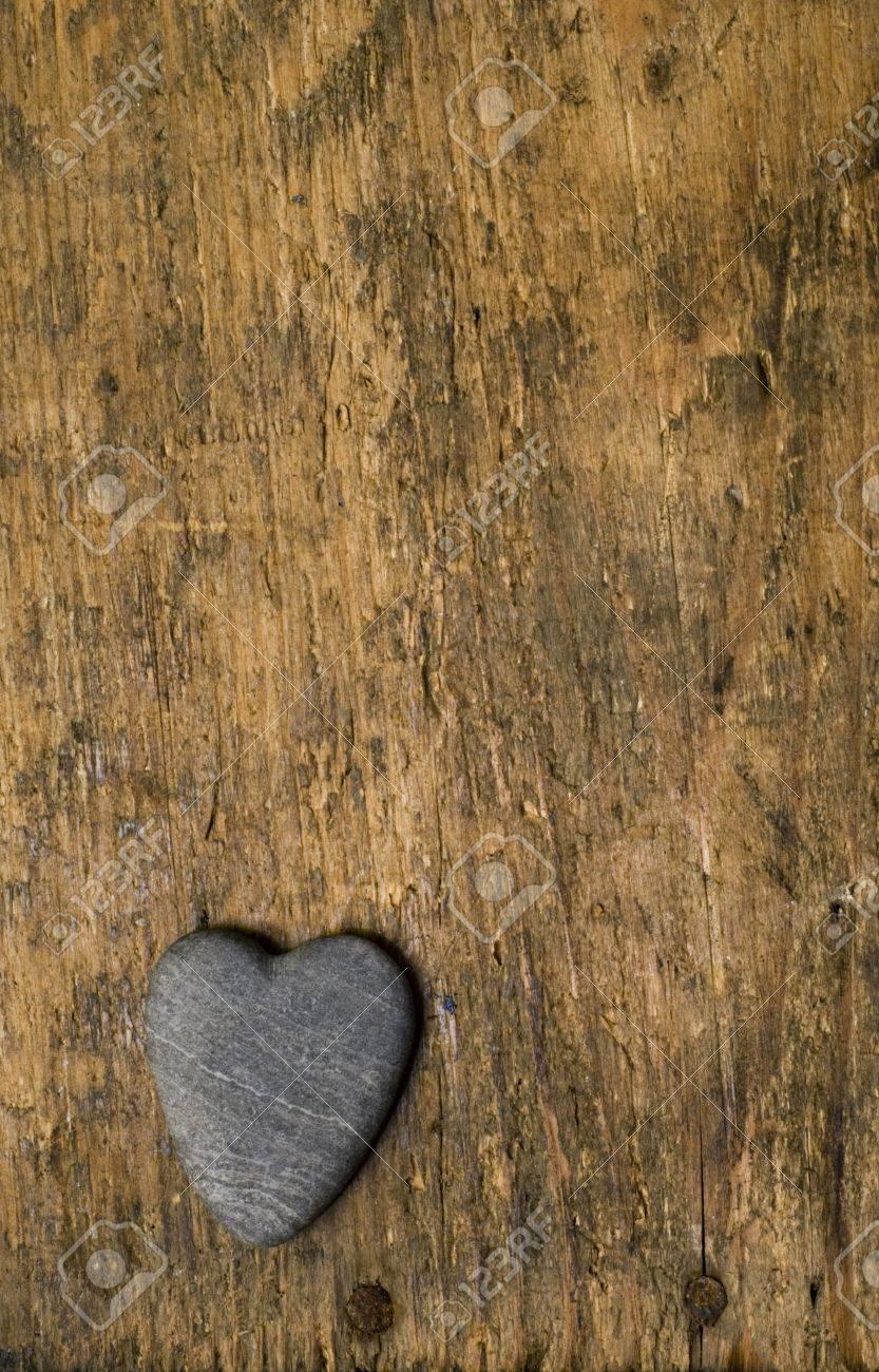 heart shaped stone on driftwood background Stock Photo - 3210480