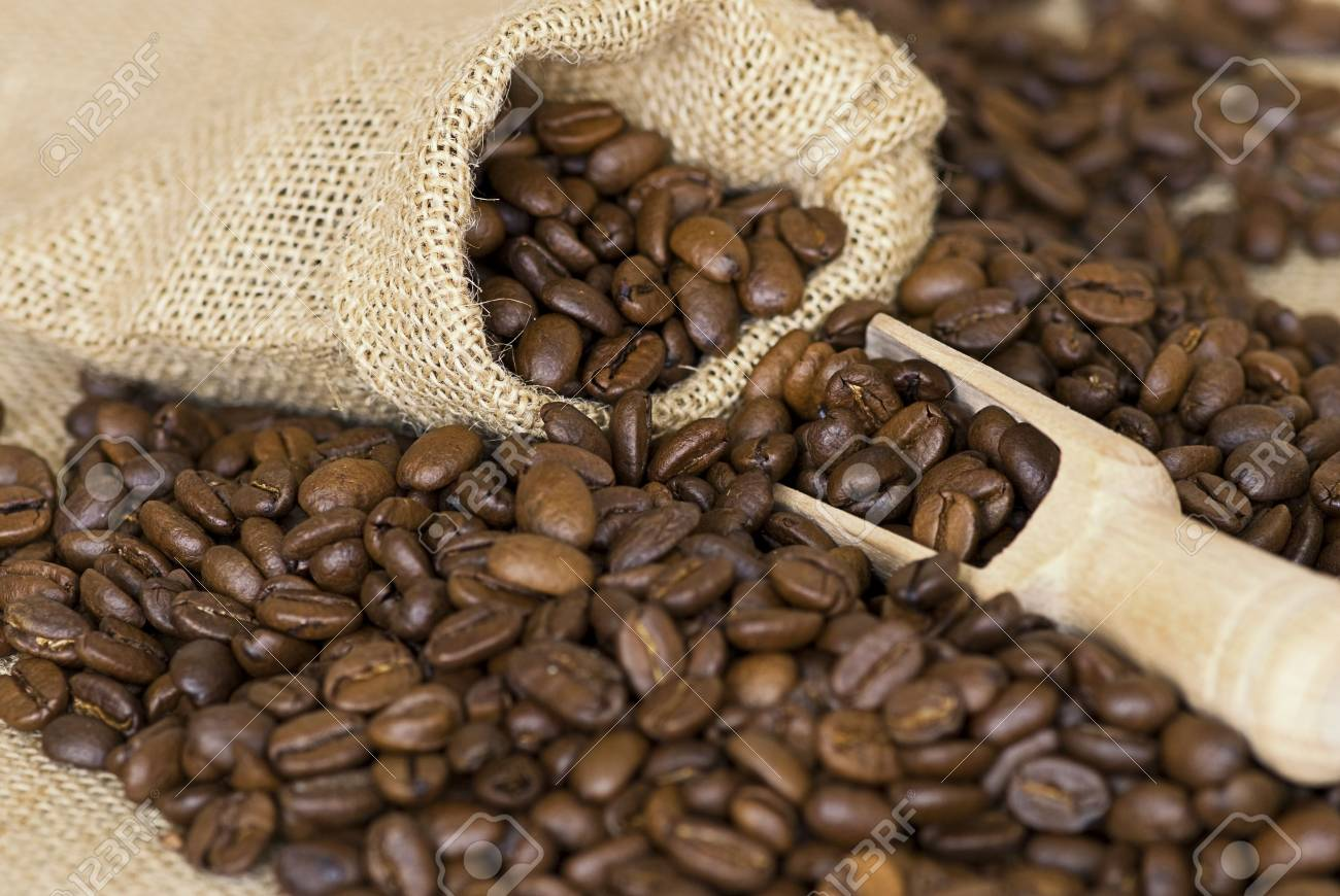 close up of coffee crop and wooden spoon Stock Photo - 6550641