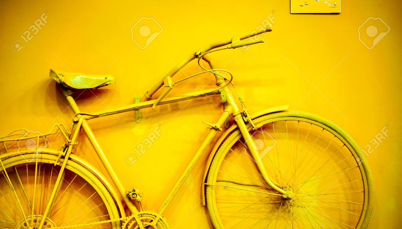 Close Up Of Bicycle As Decoration On The Wall. Old Painted Bicycle ...