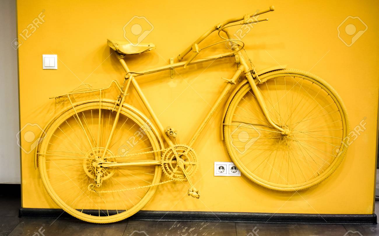 Golden Yellow Bicycle As Decoration And Power Socket And Switch ...