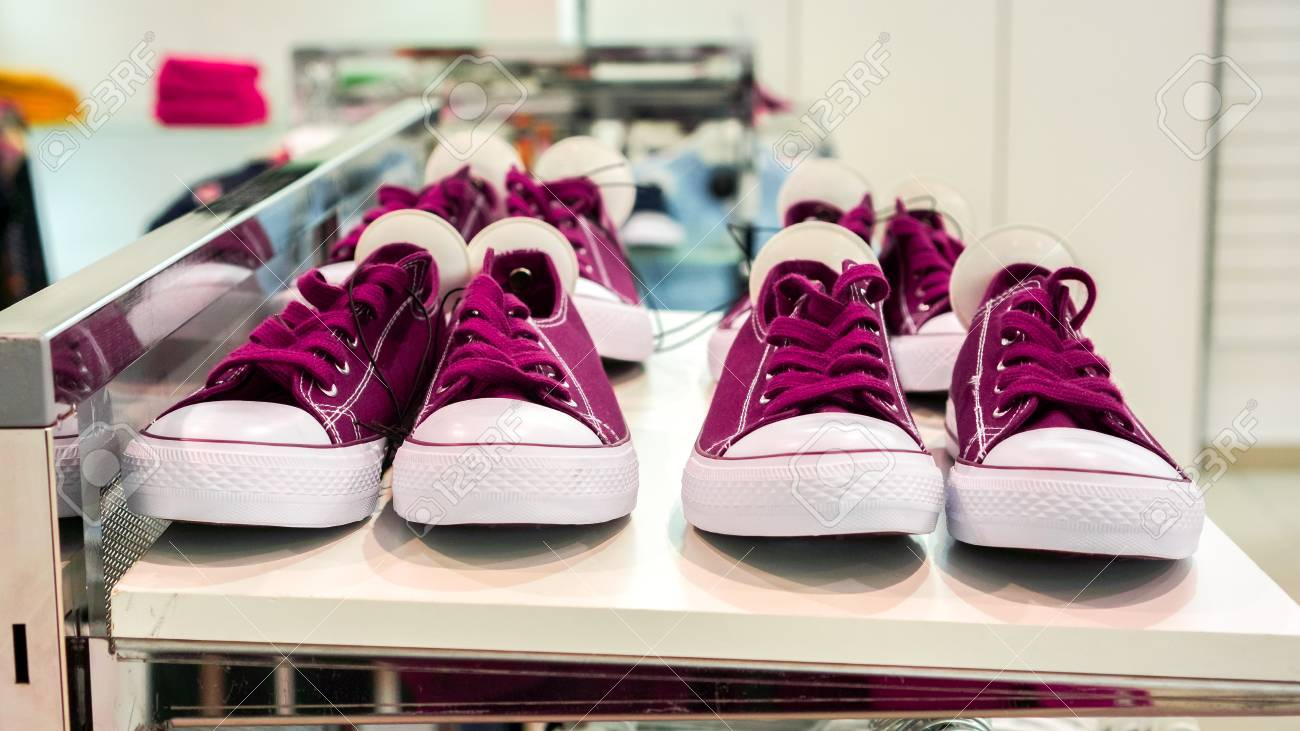cd080d0b8f78 Stock Photo - violet burgundy new different sizes sneakers shoes with white  round security magnet tags stay on white shop shelf above clothes before  sale ...
