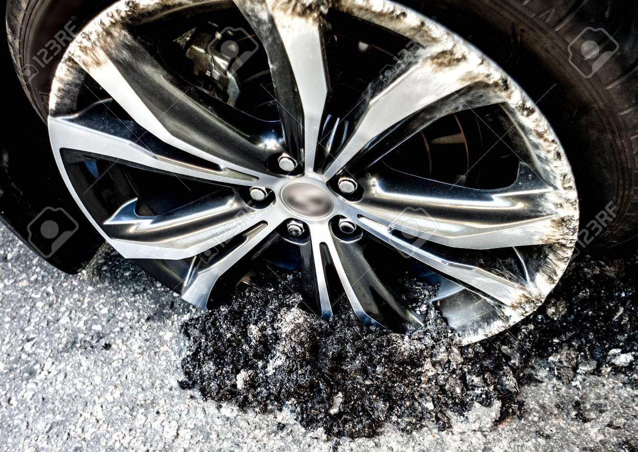 Silver Luxury Car Wheel Inside Road Asphalt After Car Crash Stock