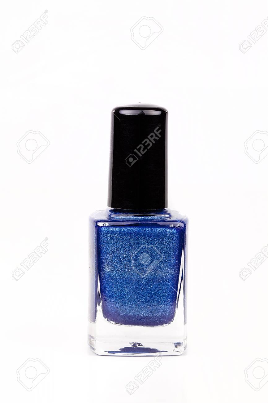Botella Azul Eléctrica Del Esmalte De Uñas En Una Superficie Blanca Esmalte De Uñas Azul Aislado Sobre Fondo Blanco