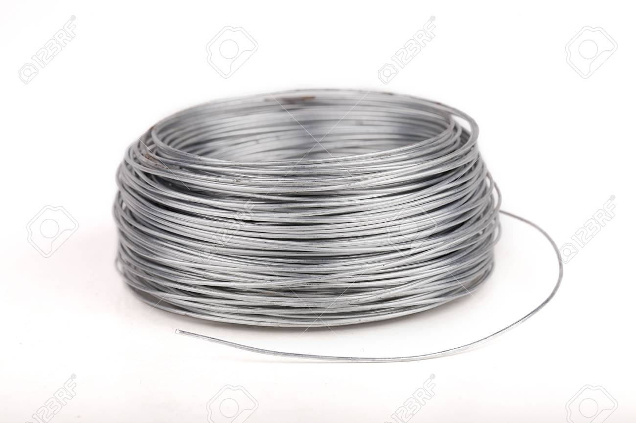 Spool Of Metal Wire On A White Surface. Roll Of Metal Wire Isolated ...