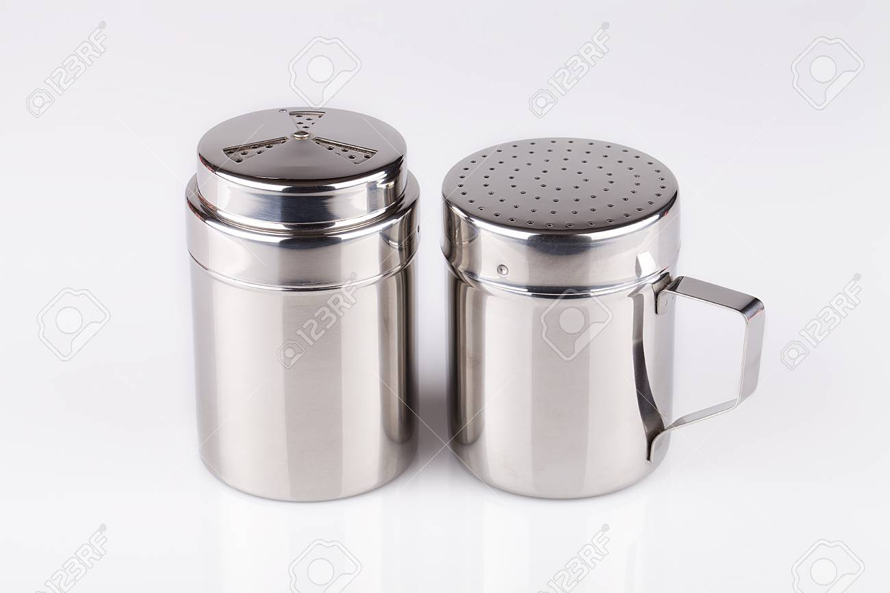 Stainless Salt Pepper Shakers On A White Surface Stainless