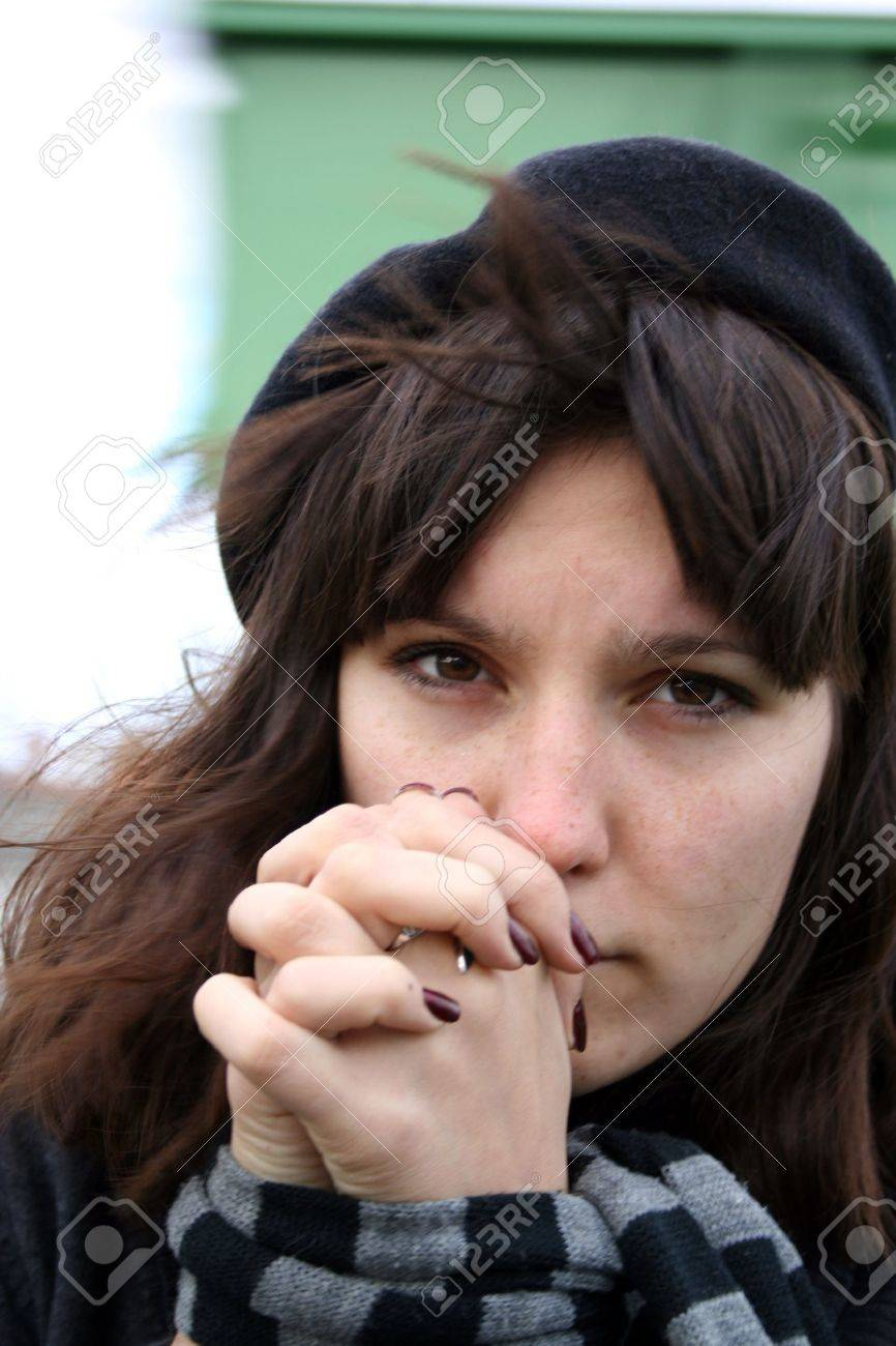 Depressed woman with captive hands. Stock Photo - 15843353