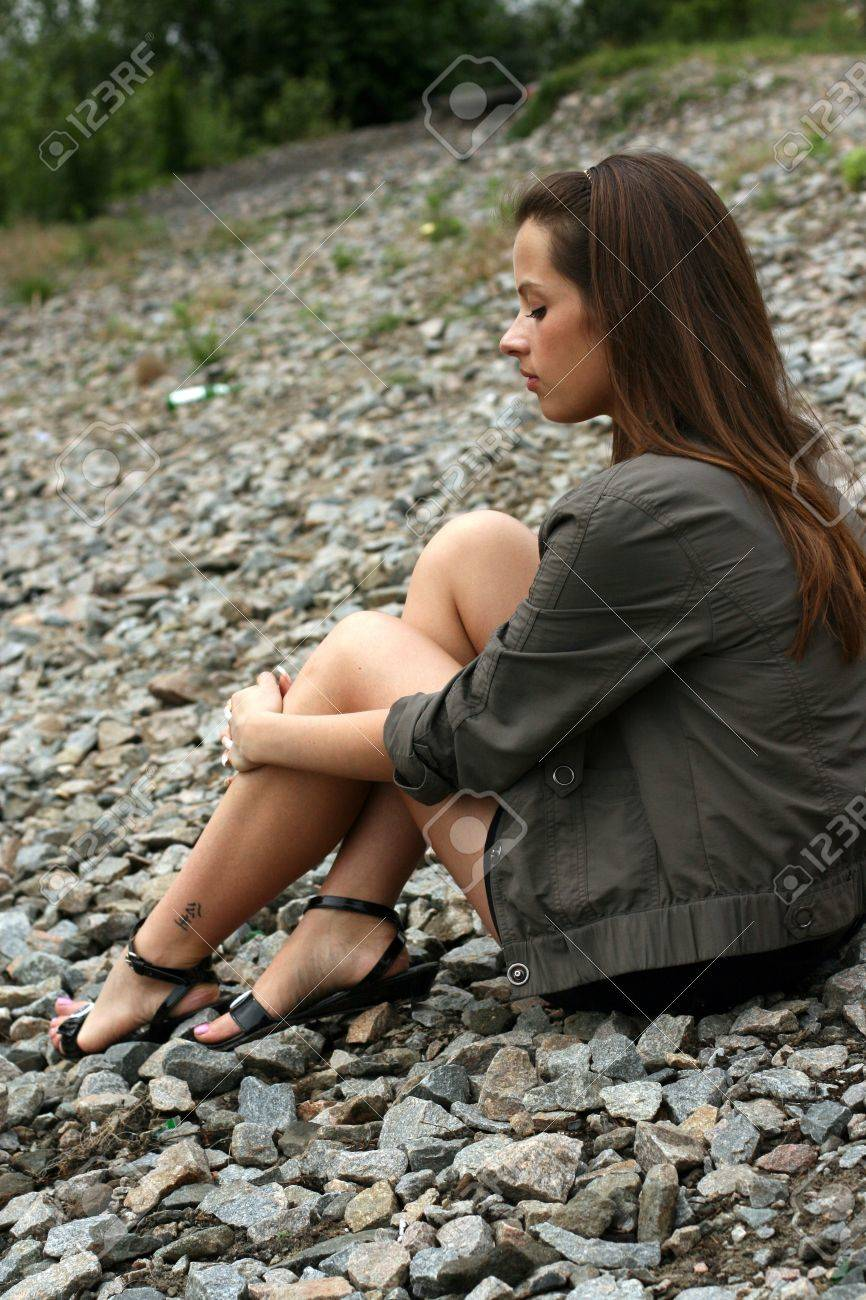 Thoughtful young woman sit on the ground. Stock Photo - 16380418