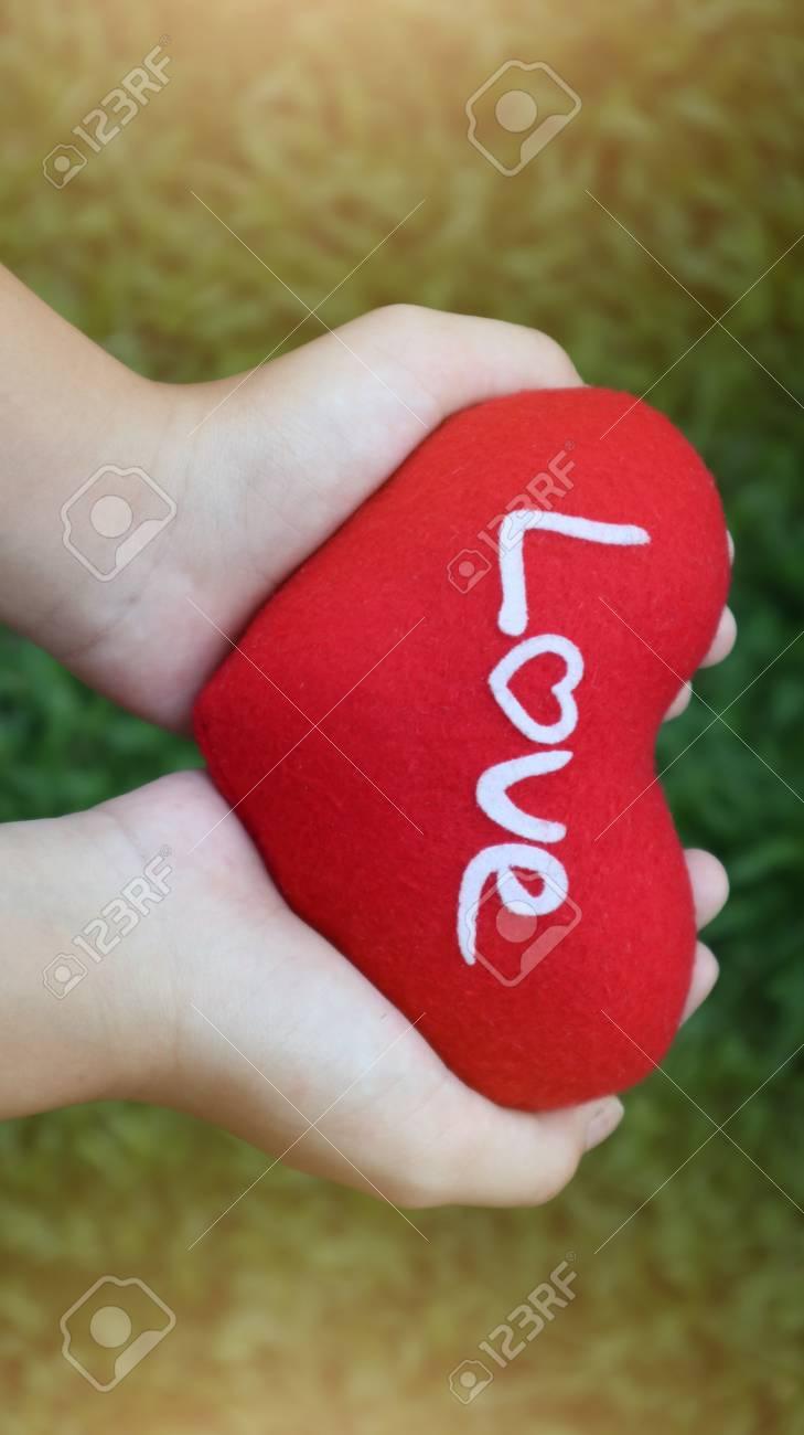 Girl Hand Holding Red Heart Write Love Wording On Green Grass ...
